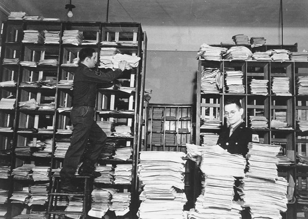 American army staffers organize stacks of German documents that were collected by war crimes investigators as evidence for the International Military Tribunal trial of war criminals at Nuremberg. United States Holocaust Memorial Museum, courtesy of National Archives and Records Administration, College Park