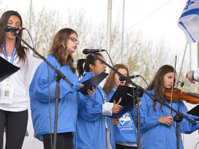 March of the Living Children's Choir sings Lay Down Your Arms at Auschwitz on Yom Hashoah 2015. EYNAT KATZ PHOTO
